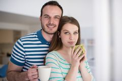 Young handsome couple enjoying morning coffee Stock Photography