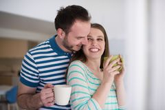 Young handsome couple enjoying morning coffee Royalty Free Stock Photography