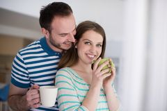 Young handsome couple enjoying morning coffee Stock Photos