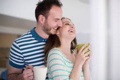 Young handsome couple enjoying morning coffee Stock Image