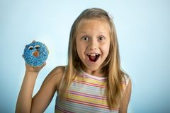 Free Young Beautiful Happy And Excited Blond Girl 8 Or 9 Years Old Holding Donut Desert On Her Hand Looking Spastic And Cheerful In Sug Royalty Free Stock Image - 111468606