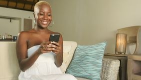 young beautiful and happy black African American woman smiling excited using internet social media app on mobile phone networking stock photography