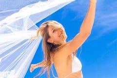 Young beautiful happy bride in white bikin Stock Image