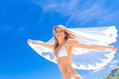 Young beautiful happy bride in white bikini holding flower bouqu Royalty Free Stock Photography