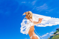 Young beautiful happy bride in white bikini holding flower bouqu Stock Images