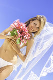 Young beautiful happy bride in white bikini holding flower  Stock Images