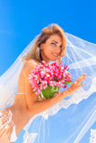 Young beautiful happy bride in white bikini holding flower Royalty Free Stock Images
