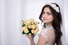 Young beautiful happy bride in white dress with flowers Stock Photography