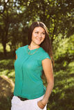 Young beautiful happy business woman in green shirt outdoors Stock Photo