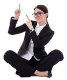 Young beautiful happy business woman sitting and pointing at som Stock Image