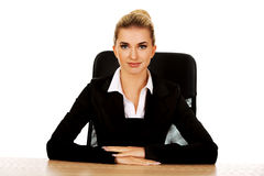 Young beautiful happy businesswoman behind the desk Stock Photography