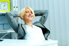 Young  beautiful happy businesswoman relaxing Royalty Free Stock Image