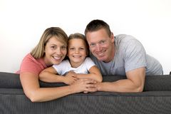 young beautiful and happy Caucasian couple with mother and father posing cheerful together with adorable 7 years old blond little stock images