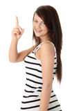 Young beautiful happy caucasian woman pointing up Stock Photo