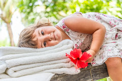 Young beautiful happy child girl relaxing on outdoor natural bac Stock Photography