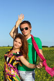 Young beautiful happy couple on the field. street. Young couple in love dancing in the park Stock Photos