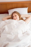 Young beautiful happy smiling blonde lady lying Royalty Free Stock Photography