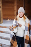 Young beautiful happy smiling girl holding sparkler. Christmas, New Year, concept. Stock Photos