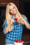 Young beautiful happy smiling woman with strawberry Stock Image