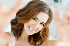 Young beautiful happy smiling woman waking up on bed Stock Images