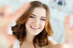 Young beautiful happy smiling woman waking up on bed Royalty Free Stock Photos