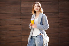 Young beautiful happy stylish hipster girl, cocktail, smoozy drink. Royalty Free Stock Photos