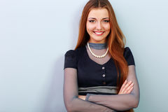 Young beautiful happy woman with arms folded Royalty Free Stock Image