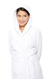 Young beautiful happy woman in bathrobe Royalty Free Stock Photography