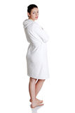 Young beautiful happy woman in bathrobe Royalty Free Stock Images
