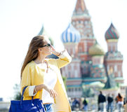 Young beautiful happy woman calling by phone in Moscow Royalty Free Stock Images