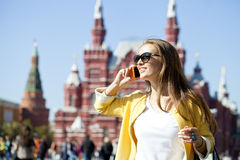 Young beautiful happy woman calling by phone in Moscow Royalty Free Stock Photo