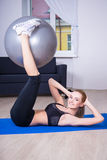 Young beautiful happy woman doing fitness exercises at home Royalty Free Stock Image