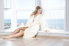 Young beautiful happy woman in the morning Royalty Free Stock Photography