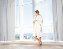 Young beautiful happy woman in the morning Royalty Free Stock Photos