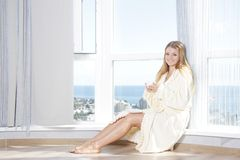 Young beautiful happy woman in the morning Stock Image