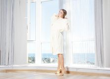 Young beautiful happy woman in the morning Stock Photography
