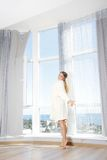 Young beautiful happy woman in the morning Royalty Free Stock Photo