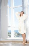 Young beautiful happy woman in the morning Royalty Free Stock Image
