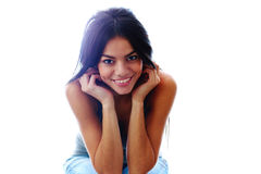 Young beautiful happy woman sitting isolated Royalty Free Stock Photography