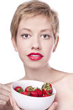 Young beautiful happy woman with strawberry Stock Photos