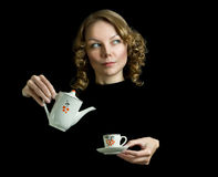 Young beautiful happy woman with teapot Stock Photo
