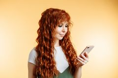 Young beautiful happy woman using smart phone royalty free stock photo