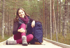 Young, beautiful and happy woman walking in forest. Camp, advent Royalty Free Stock Images