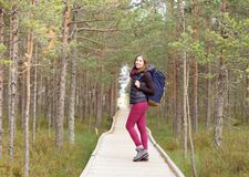 Young, beautiful and happy woman walking in forest. Camp, advent Royalty Free Stock Photos