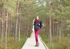 Young, beautiful and happy woman walking in forest. Camp, advent Stock Photography