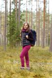 Young, beautiful and happy woman walking in forest. Royalty Free Stock Photos