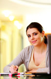 Young beautiful happy woman writing notes Stock Photography