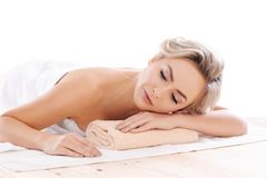Young, beautiful and healthy girl relaxing in spa salon. Rejuvenation therapy and massaging treatments. Recreation Stock Images