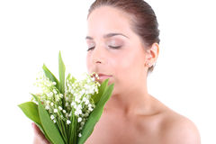 Young beautiful healthy woman with flowers. Portrait of a young beautiful healthy woman with flowers Royalty Free Stock Photo