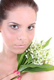 Young beautiful healthy woman with flowers. Portrait of a young beautiful healthy woman with flowers Royalty Free Stock Images